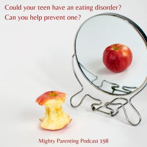 small mirror shows image of red apple while an apple core sits on table to show effect of eating disorders